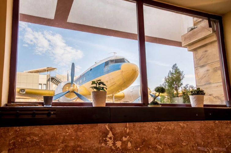 View at dakota aircraft from window garden dakotas beer pub excellent craft fun vibes argyroupoli region - 4